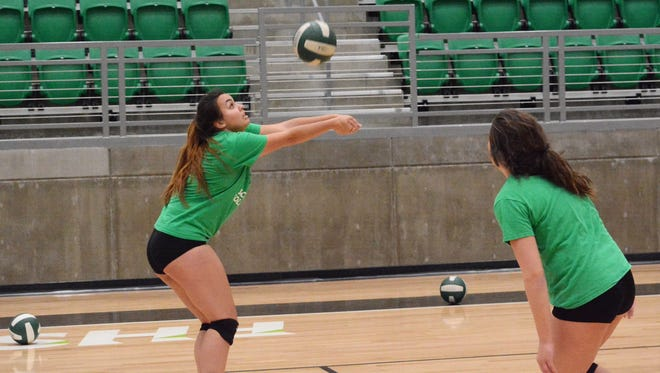 Farmington's Donna Hall passes the ball down the left side during Monday's practice at Scorpion Arena. FHS earned the No. 4 seed in this year's 5A state volleyball championships.