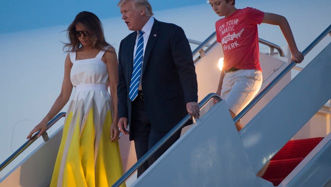 The Trumps return from a Trump resort in Bedminster, N.J.