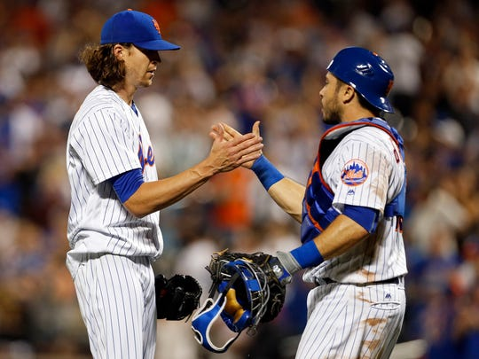 Jun 12, 2017; New York City, NY, USA; New York Mets starting pitcher Jacob deGrom (48) celebrates with Mets catcher Travis d'Arnaud (18) after defeating the Chicago Cubs at Citi Field. Mandatory Credit: Adam Hunger-USA TODAY Sports