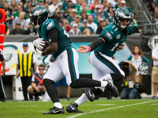 Eagles' Carson Wentz hands off to LeGarrette Blount during their game Sunday at Lincoln Financial Field.