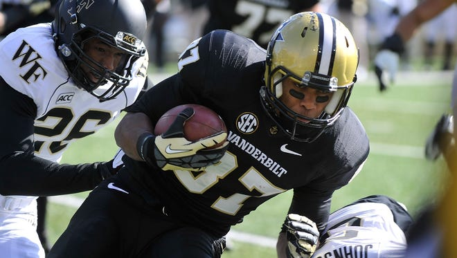 NASHVILLE, TN - NOVEMBER 30:  Wide receiver Jordan Matthews #87 of the Vanderbilt Commodores makes a reception against the Wake Forest Demon Deacons at Vanderbilt Stadium on November 30, 2013 in Nashville, Tennessee.  (Photo by Frederick Breedon/Getty Images)