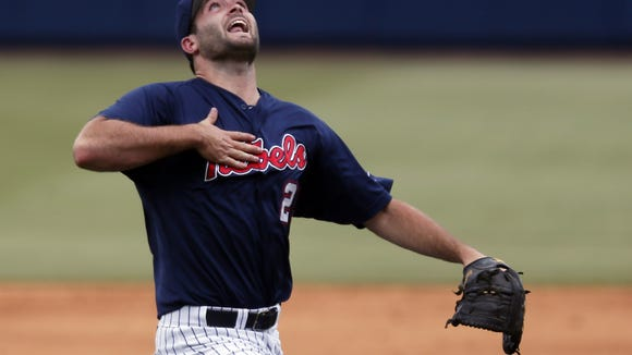 Mississippi pitcher Sam Smith (29) calls for a second inning Washington pop fly in the second inning of an NCAA college baseball regional tournament championship game in Oxford, Miss., Monday, June 2, 2014. (AP Photo/Rogelio V. Solis)
