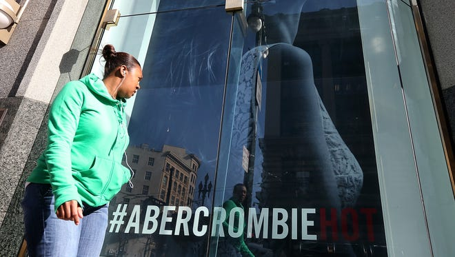 SAN FRANCISCO, CA - FEBRUARY 22:  A woman stand near an Abercrombie and Fitch store on February 22, 2013 in San Francisco, California.