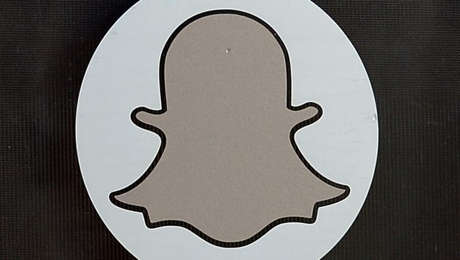 The Snapchat logo is seen at the front entrance new headquarters of Snapchat in Venice Beach, CLif.
