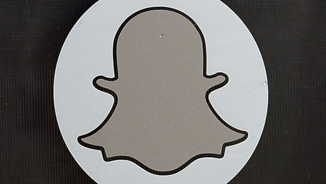 The logo of Snapchat is seen at the front entrance of the Venice, Calif., headquarters of Snapchat, the popular social network startup that lets users send each other photos that quickly disappear, November 14, 2013 in. Snapchat recently turned down a $3-billion buyout offer from Facebook.