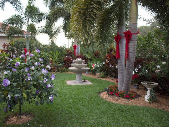 Phyllis and Larry McCommon decorate their Naples garden for an annual Christmas party.