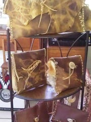Kim Cruickshank will have leather shoulder bags trimmed with coyote fur on display at the festival.