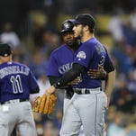 Rockies bring back 3 coaches as they search for new manager