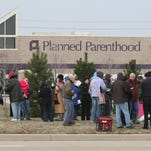 Anti-abortion protestors hold a prayer vigil outside Planned Parenthood on the northside of Indianapolis on Dec. 13, 2008.