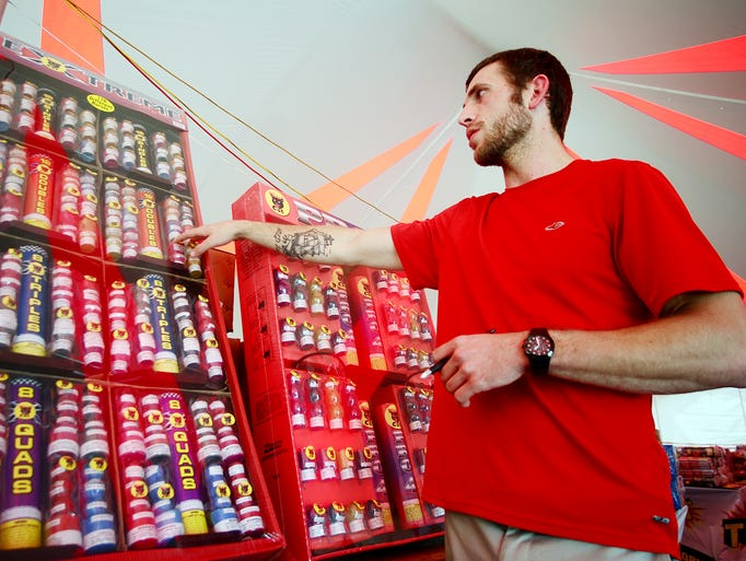 Manager of Loco Joe's Fireworks Nicholas Field talks about the bestselling fireworks Monday at the stand's location on Hwy. 98 West.