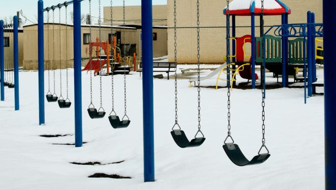 Playground at school in winter with snow on the ground