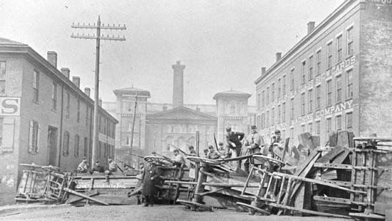 National Guard troops man a barricade in 1884 during a riot sparked by political corruption.