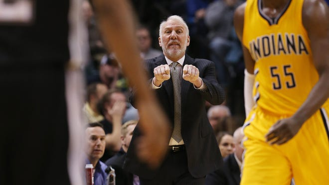 Spurs coach Gregg Popovich won his 1000th game with a 95-93 win over the Pacers. The Pacers hosted the Spurs at Bankers Life Fieldhouse Monday, February 9, 2015.