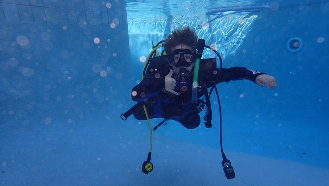 Scuba diving adds a new dimension to family vacations. Here: AJ Duda in full dive gear