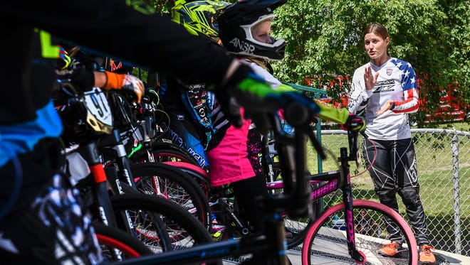 Olympic BMX medalist Alise (Post) Willoughby works with riders on their starts during a clinic Tuesday, July 17, at the Pineview Park BMX track.