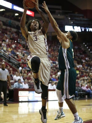 FSU's Benji Bell puts a shot up against Southeastern Louisiana's Dimi Cook during their game at the Civic Center on Sunday.