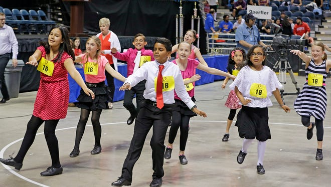 Students from Elm Dale School dance in a Latin style as they join about 2,000 local students from area schools in the annual Mad Hot Ballroom and Tap competition at the BMO Harris Bradley Center on May 21. This is the 10th year for this program where students competed in the tap portion (funky, Latin and swing styles) and ballroom competition.