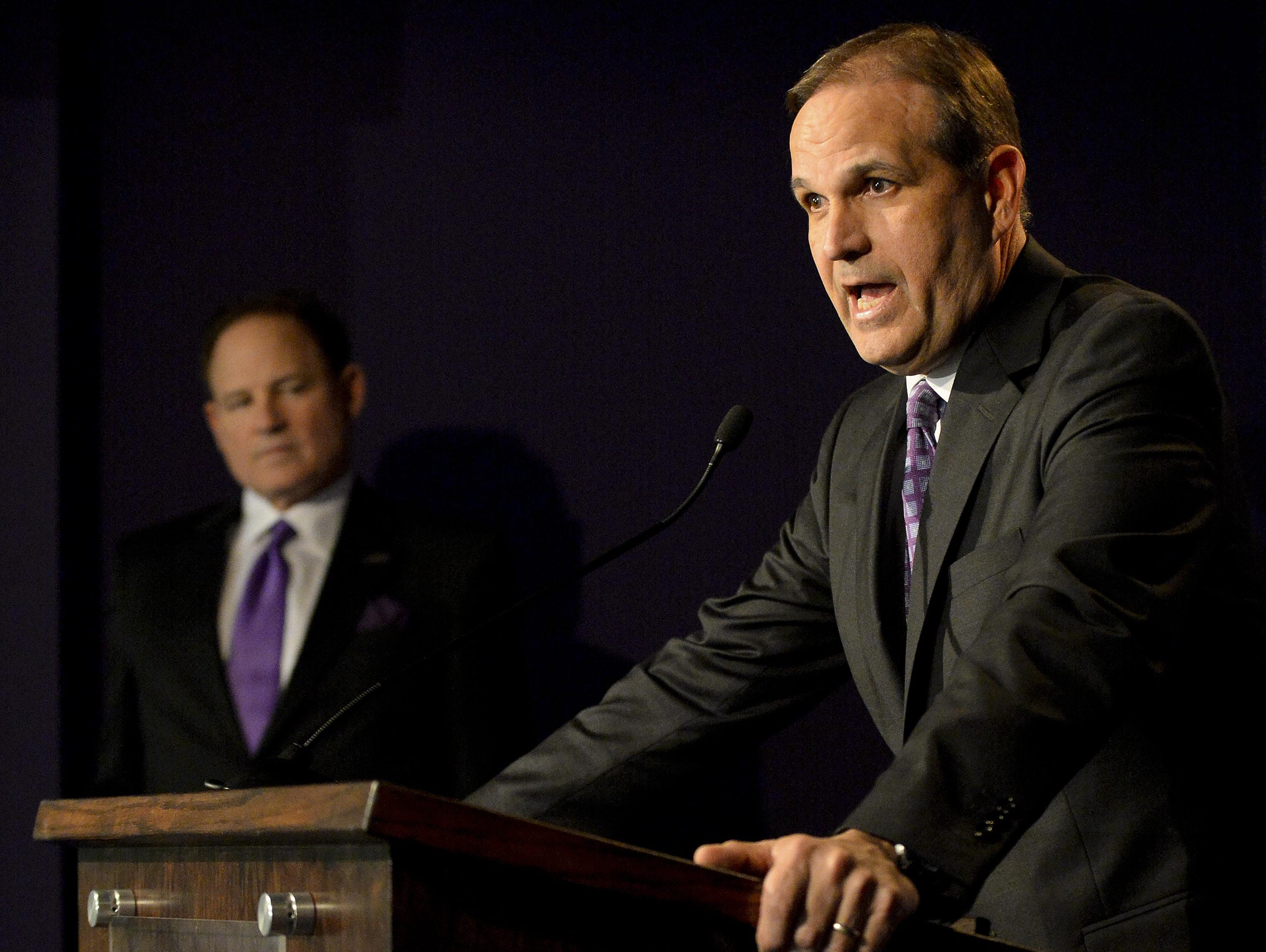 New LSU defensive coordinator Kevin Steele, right, speaks during a press conference in January.