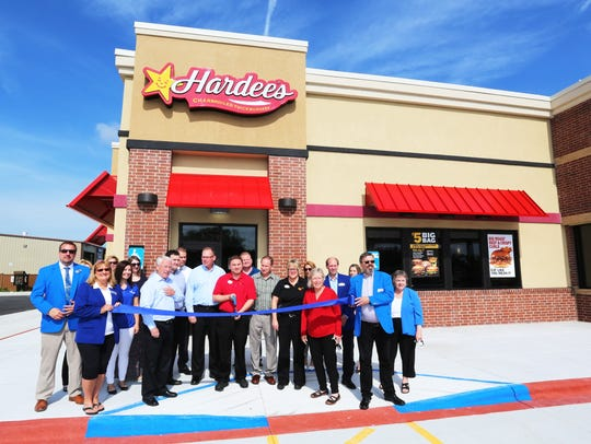 Chamber of commerce officials at the ribbon cutting