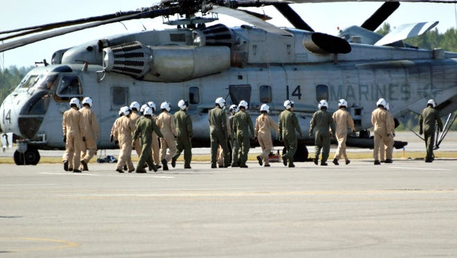 Naval Air Station Whiting Field students walk to Seahawk helicopter