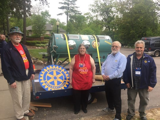 Farmington Rotary Club President Lynn Morgan, District Polio Chair Ginger Barrons, Rotarians Phil Abraham and Lee Barrons showing off the iron lung brought down from Northern Michigan.