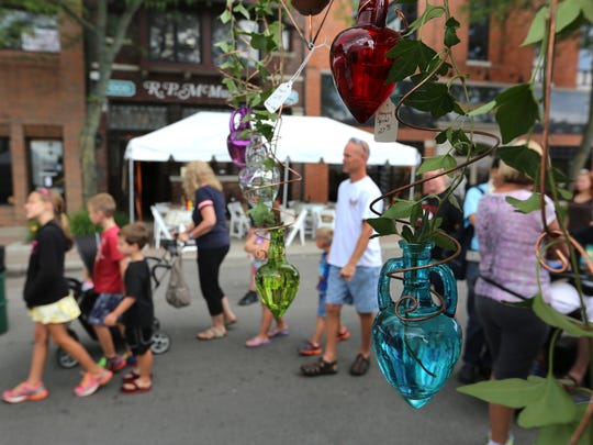 Families walk among the displays at the 53rd annual
