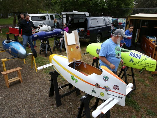 Racers prepare cars for the Soap Box Derby at Bush's Pasture Park on Saturday, May 23, 2015, in Salem, Ore.