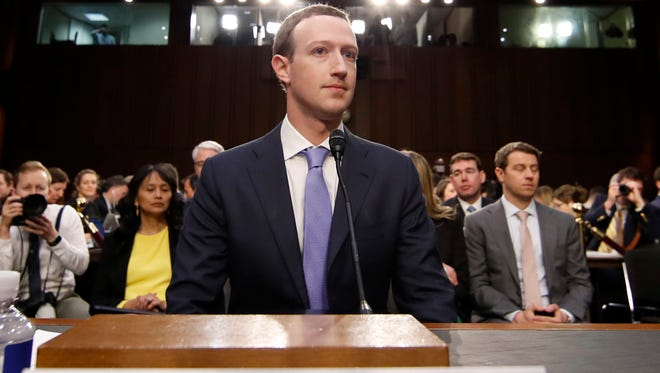 Facebook CEO Mark Zuckerberg takes his seat after a break to continue to testify before a joint hearing of the Commerce and Judiciary Committees on Capitol Hill in Washington, Tuesday, April 10, 2018, about the use of Facebook data to target American voters in the 2016 election.