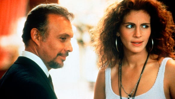 Hector Elizondo and Julia Roberts in a scene from