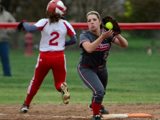 Bellevue's first baseman Jena Weider stretches to no avail as Port Clinton's Taylor Steyer is safe at first base.