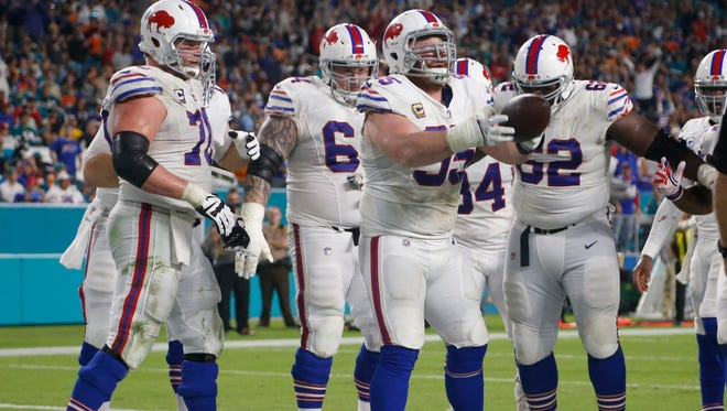 Buffalo Bills defensive tackle Kyle Williams (95) celebrates with his teammates after scoring a touchdown, during the second half of an NFL football game, Sunday, Dec. 31, 2017, in Miami Gardens, Fla.