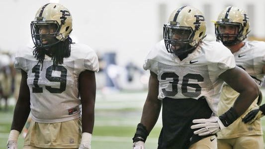 Linebackers Dezwan Polk-Campbell (19) and Danny Ezechukwu (36) during football practice Thursday, March 24, 2016, inside the Mollenkopf Athletic Center on the campus of Purdue University.