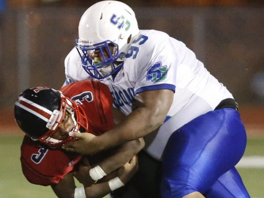 All-State defensive tackle Jhemir Stanley makes it tough to run against St. Georges.