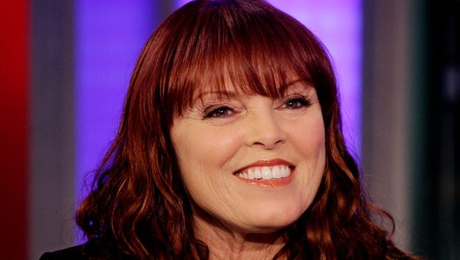 "FILE - In a Tuesday, June 15, 2010 file photo, singer Pat Benatar appears on the ""Fox & Friends"" television program in New York. Macy's announced Monday, Nov. 2, 2015 that Benetar, Mariah Carey, Questlove from the Roots, the cast of ""Sesame Street,"" and Neil Giraldo will be among the stars celebrating at Macy's Thanksgiving Day Parade on Nov. 26, 2015.(AP Photo/Richard Drew, File)"