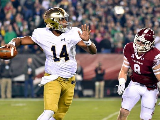 Notre Dame Fighting Irish quarterback DeShone Kizer (14) is chased by Temple Owls linebacker Tyler Matakevich (8) during a game at Lincoln Financial Field.