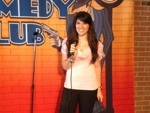 Features reporter Gina Columbus strikes a pose on stage at Uncle Vinnie's Comedy Club in Point Pleasant Beach.