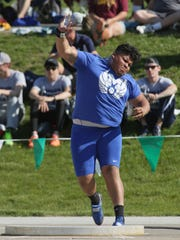 Maysville Panthers' Kyler Hooper throws the shot put during the Division II state track meet Friday at Jesse Owens Memorial Stadium. He finished eighth to earn All-Ohio honors.