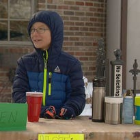 PHOTOS: Boy braves cold temps for Children's Hospital fundraiser
