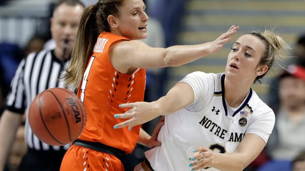 Notre Dame's Marina Mabrey (3) passes the ball as...