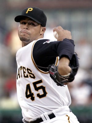 Pittsburgh Pirates starting pitcher Ian Snell throws against the Chicago Cubs in the first inning of a  baseball game in Pittsburgh in 2008.