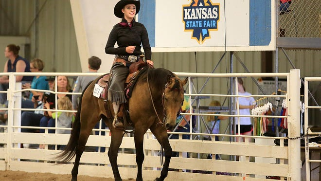 Kendall Schoenhals, 17, competes on her 5-year-old horse, Tag, in the 4-H Horse Show on Friday afternoon at the Expo Center on the Kansas State Fairgrounds.