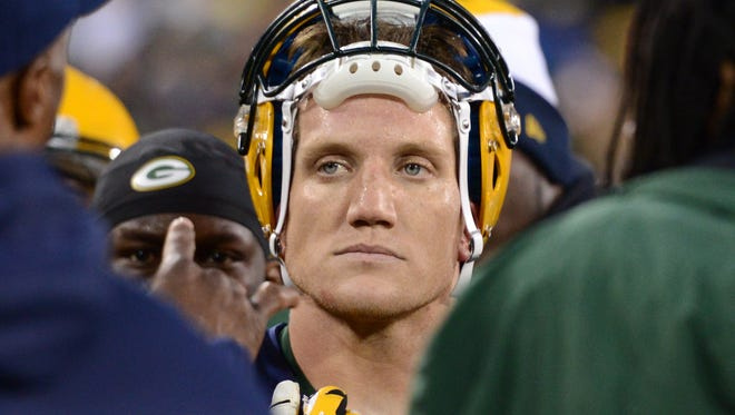 Green Bay Packers linebacker A. J. Hawk on the sidelines during the game against the Cleveland Browns at Lambeau Field, Sunday, October 20, 2013.