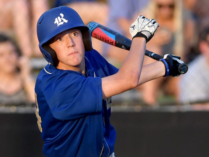 Riverside's Seth Tims looks up at a hit ball during