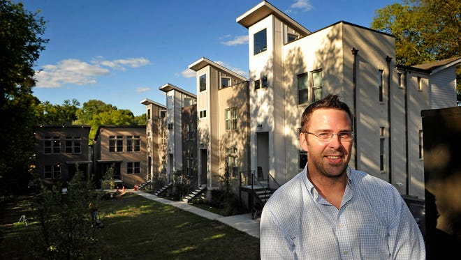 Walker Shell poses for a photo at his home in SoHo Commons, a cluster development of nine new homes built by Red Horse Builders + Developers in Wedgewood-Houston.