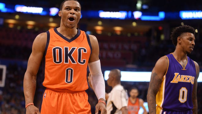 Oklahoma City Thunder guard Russell Westbrook (0) and Los Angeles Lakers forward Nick Young (0) react after a play during the third quarter at Chesapeake Energy Arena.