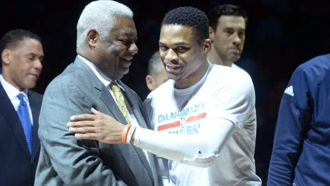 NBA great Oscar Robertson (left) congratulates Oklahoma City Thunder guard Russell Westbrook (0) during a presentation honoring him for breaking Robertson's single-season triple-double record prior to a game against the Denver Nuggets at Chesapeake Energy Arena on April 12.