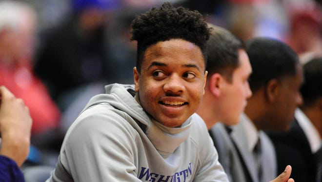 Markelle Fultz looks on from the bench during a game against the Washington State Cougars.