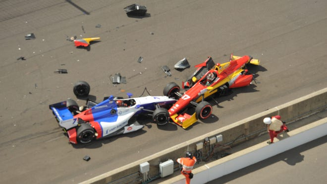 The cars of Sebastian Saavedra (right), Mikhail Aleshin (left) and Carlos Munoz (not pictured) suffered heavy damage at the start of Indianapolis Motor Speedway's inaugural road course race when Saavedra's car failed to launch properly.