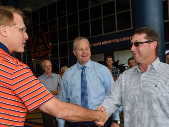 New Auburn baseball coach Butch Thompson shakes hands
