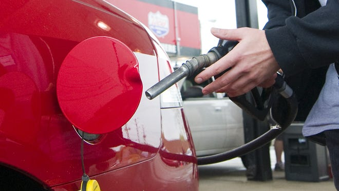 A motorist prepares to add gasoline to his vehicle's tank in Clermont, Indiana.